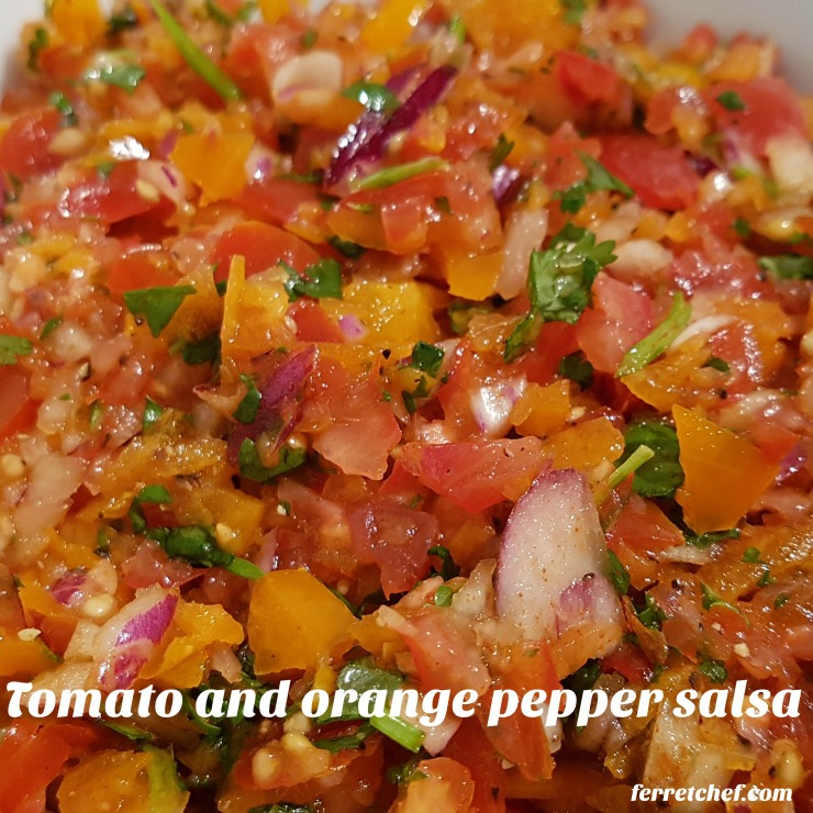 tomato orange pepper salsa close up